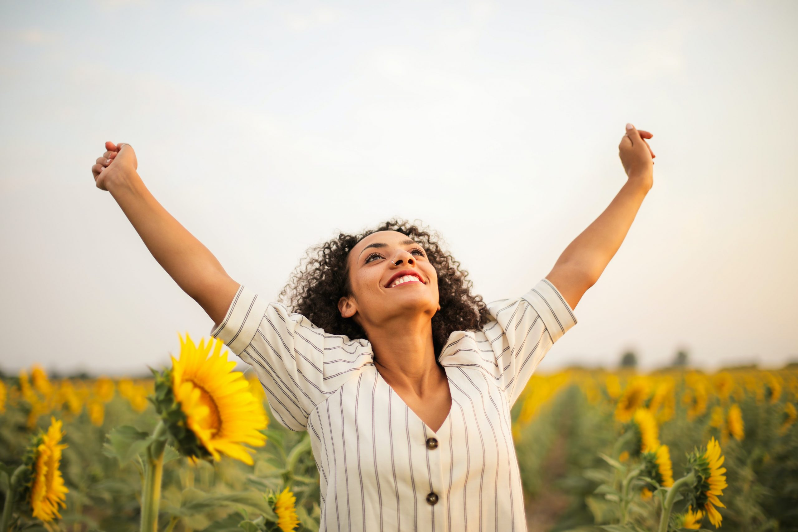 photo of woman standing on sunflower field 3756168 scaled